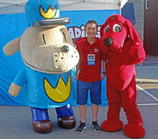 Max and literary characters Dog Man and Clifford at the Scholastic Summer Reading Road Tour in Dedham, MA