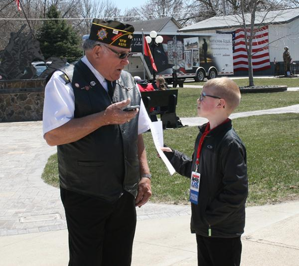 Brandon interviewing the event organizer, Jerry Christensen about why he brought the memorial to Britt, IA.