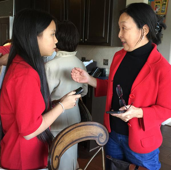 Bridget talks with Alice Yi, president of the Austin chapter of the Asian Pacific Islander American Public Affairs Association (APAPA).