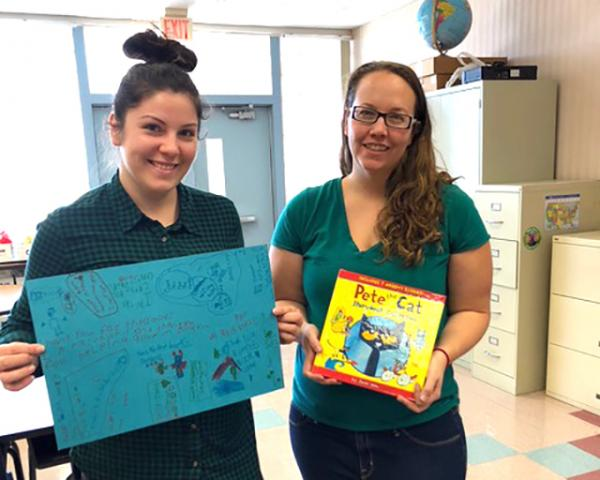 Survivors Chrystal Nelson and Traci Wickham collected 1,000 new books for children.