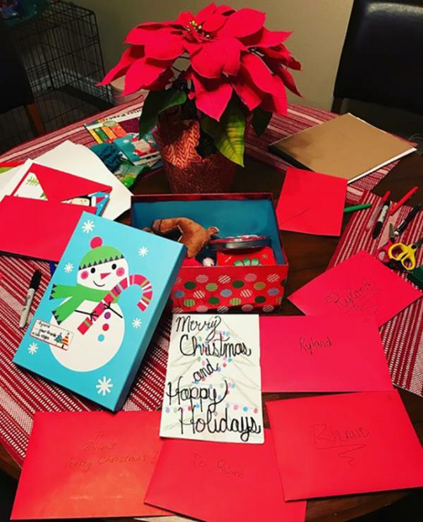 Handwritten holiday cards for a young shooting survivor in Texas