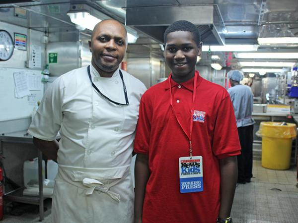 Caleb and chef Serge Nzembele in the galley of the ship