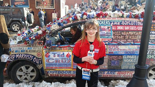 Kaitlin in front of a minivan that the owner transformed into a rolling billboard for Cruz