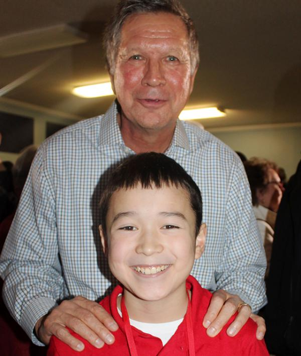 "Ohio Governor John Kasich with Maxwell Surprenant at a ""town hall"" event in Goffstown, New Hampshire."