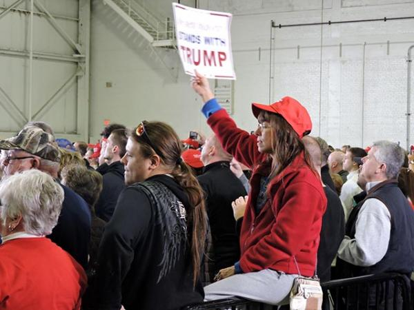 Trump supporters listen to the presidential candidate speak at a Super Tuesday rally in Columbus, Ohio.