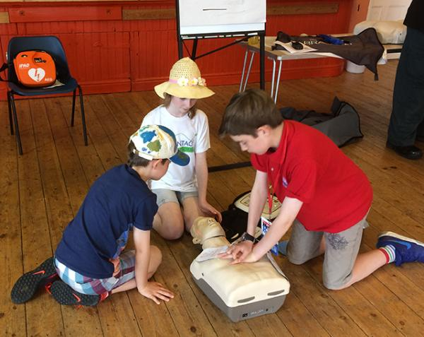 Martin practising CPR at the Defibrillator training day