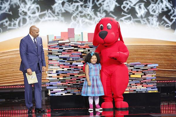 Daliyah with Steve Harvey and Clifford the Big Red Dog and the book donations that were made to Reach Out and Read in Daliyah's honor