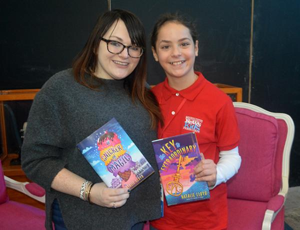 Sadie with author Natalie Lloyd displaying Lloyd's two novels.