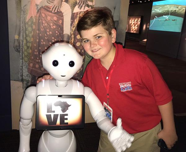 Nolan with Pepper the robot at the National Museum of African Art