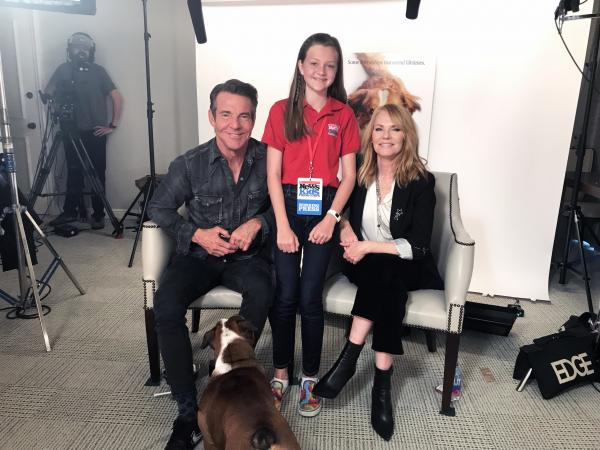 Kid Reporter Annika Petras stands with Dennis Quaid and Marg Helgenberger, stars of the new film, a Dog's Journey.