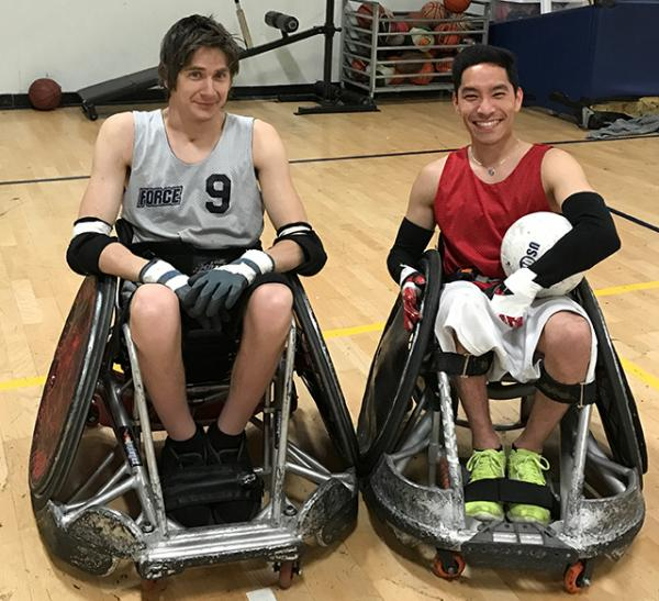 Steven Toyoji (right) with teammate Grayson Holden at a wheelchair rugby practice.