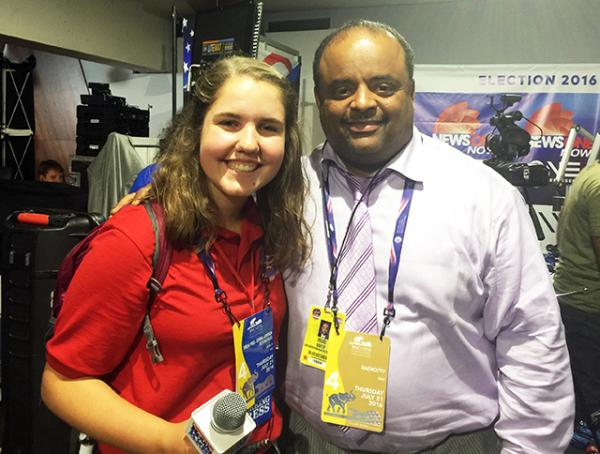 Kyra with political commentator and social justice activist Roland Martin