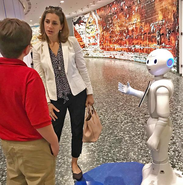 "Nolan talks with Rachel Goslins at the Hirshhorn Museum and Sculpture Garden as ""Pepper"" looks on."