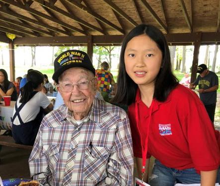 Teresa with J. B. Caldwell, a decorated U.S. war veteran, at his 93rd birthday party in North Carolina
