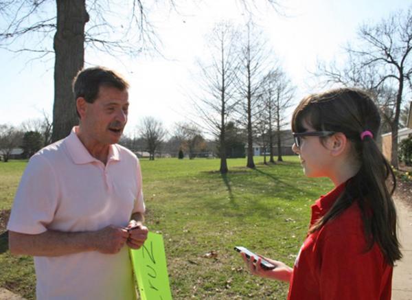 Esther interviews voter Craig Fenton in St. Louis, Missouri.