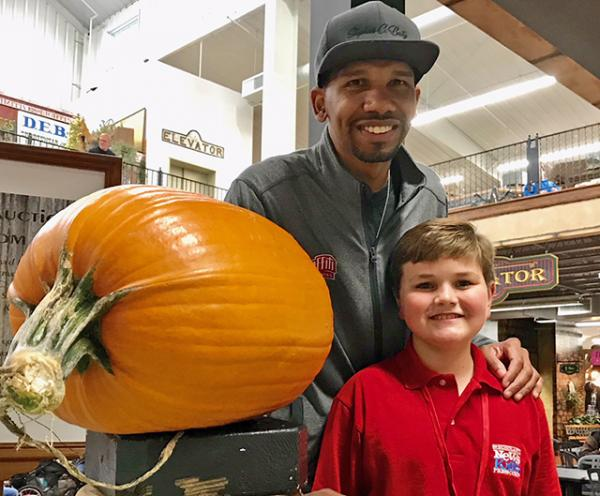 Nolan and Chef Baity at the Extreme Pumpkin Carving Event. Hartville Marketplace, Hartville Ohio (photo by Mary Pastore)