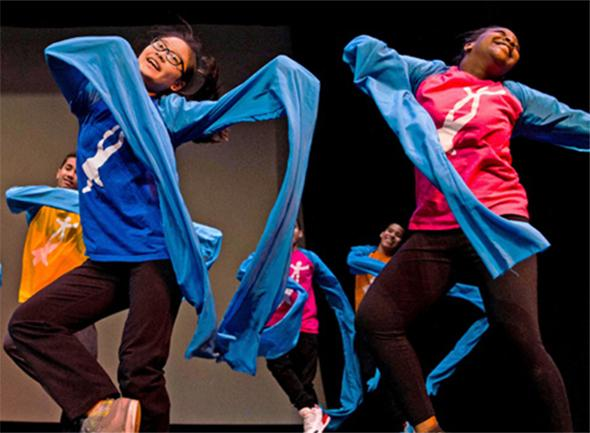 Children from the National Dance Institute in New York City perform a Chinese dance. Their performance was part of a cultural exchange program involving children from the United States and China.
