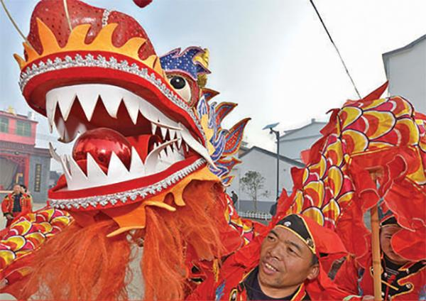 Villagers in China's Jiangxi province perform a traditional dragon dance to celebrate the Lunar New Year.