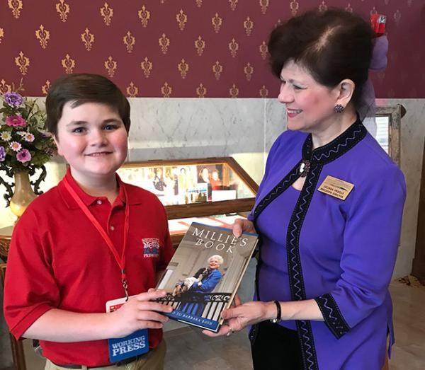 Nolan with one of the books authored by Barbara Bush and Lucinda Frailly, Director of Education, National First Ladies' Library Canton, Ohio.