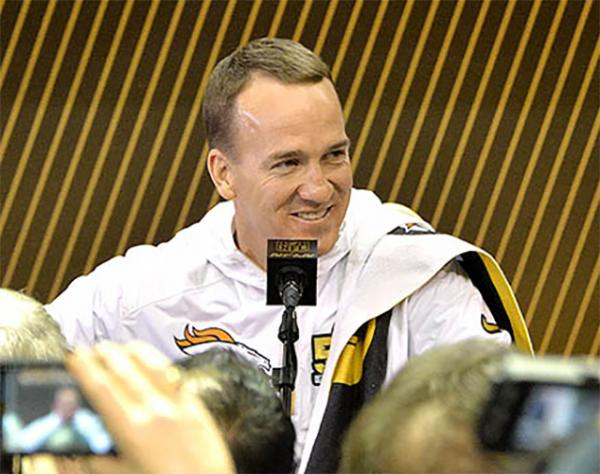 Quarterback Peyton Manning of the Denver Broncos answers reporters' questions at Opening Night of Super Bowl 50 in San Jose, California. Manning is seeking his second Super Bowl ring.