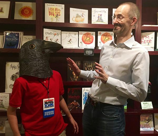 Max wears The Raven mask as Gareth Hinds looks on.