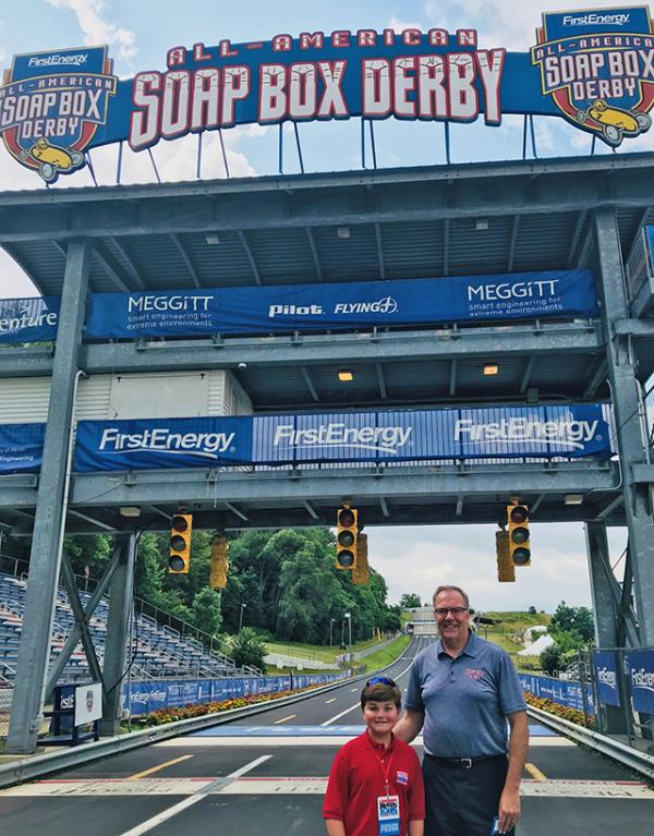Nolan at the finish line with Mark Gerberich, president, and CEO of the Soap Box Derby