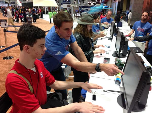 """David Coar an Engineer with Lockheed Martin shows Erik Weibel how they are developing hands-free technology to steer rover vehicles to investigate other planets. """"We are representing future technology."""""""