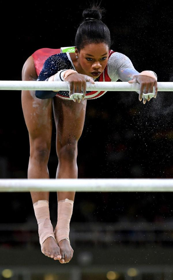 Gabby Douglas on the uneven bars at the 2016 Summer Olympics