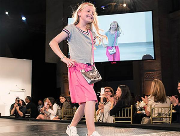 Maddie Hostetter models an outfit at a fashion show in New York City benefiting the Runway of Dreams Foundation. The organization helps bring adaptive clothing to differently abled people.