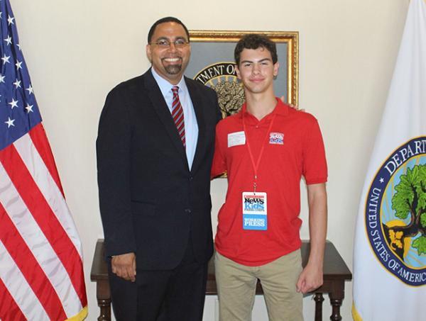 Erik with US Secretary of Education, Dr. John King