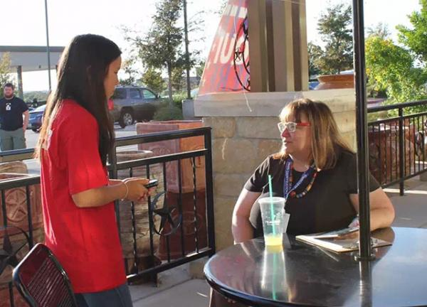 Bridget speaks with Joan Carr, a local poll worker