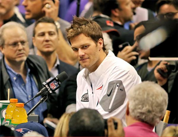 New England Patriots quarterback Tom Brady answers questions at Super Bowl Media Day.