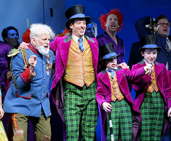Cast members of Charlie and the Chocolate Factory, a new musical on Broadway, after a recent performance. The show is based on Roald Dahl's novel of the same name. It stars Christian Borle, center, as Willy Wonka, the eccentric owner of a chocolate factory.