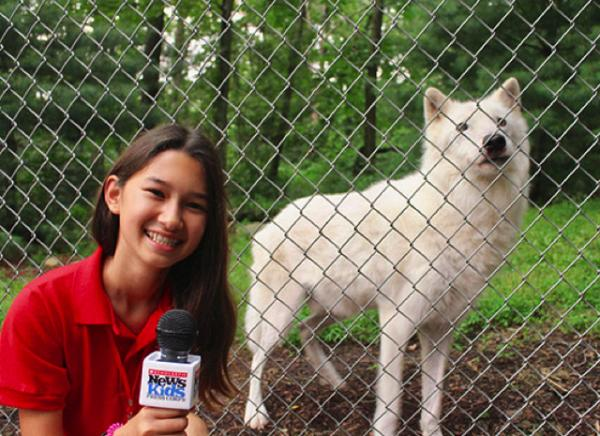 Ava with Atka, an Artic Gray wolf at the Wolf Conservation Center in South Salem, NY.