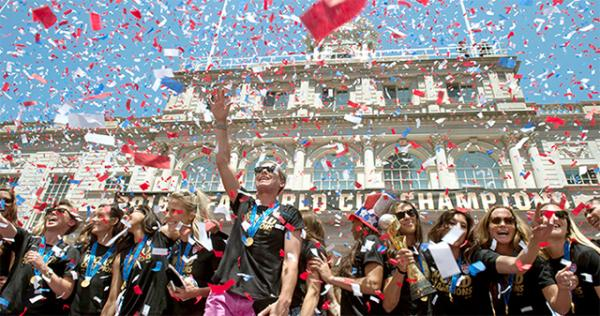 In a flurry of confetti, Abby Wambach (center) and her teammates celebrate the U.S. Women's World Cup soccer championship at City Hall in New York City.