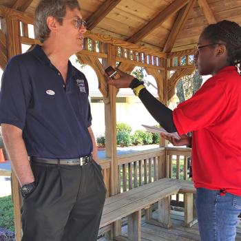 Alaa interviews voter Carter Cheatum.