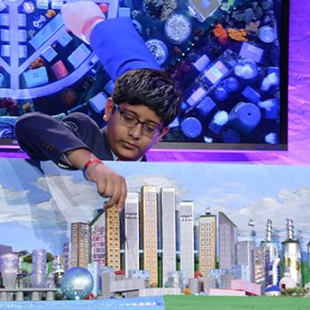 "Vinay Ayalya with his team's winning model city, ""Halona"""