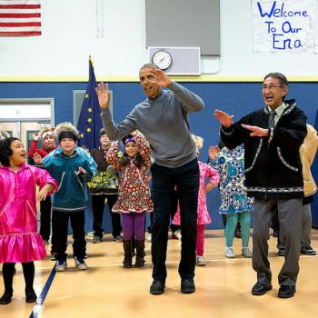 The President joins locals during a cultural dance performance at Dillingham Middle School in Dillingham, Alaska.