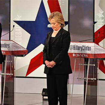 The candidates bow their heads in silence to honor the victims of the terrorist attacks in Paris, France. Left to right: Vermont Senator Bernie Sanders, former Secretary of State Hillary Clinton, and former Maryland Governor Martin O'Malley.