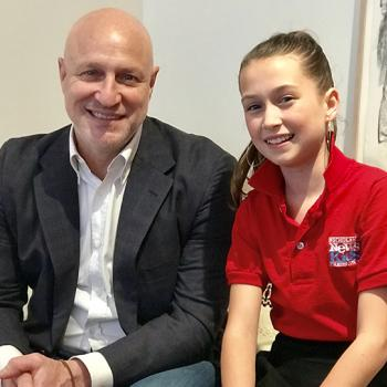 Amelia with Tom Colicchio, a chef based in New York City who is featured on Bravo's Top Chef.