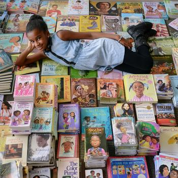 Marley Dias with some of the books that she has collected