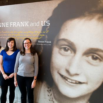 Charlotte (left) with Hannah Vaughn (center) and Beth Slepian near the entrance of the Anne Frank Center USA in New York City