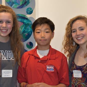 Stone with Acton-Boxborough high school students Anna Rychlik and Chantal Raguin