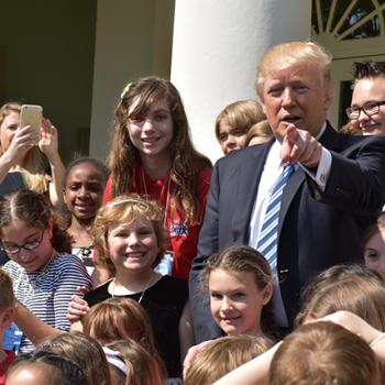 President Donald Trump with Lillian (to his right) and other kids in the Rose Garden of the White House.