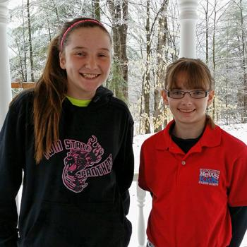 Kid Reporter Kaitlin Clark and Delaney Pickering in her basketball team sweatshirt.