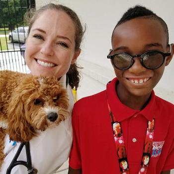Dr. Catherine Foret and Grits the dog