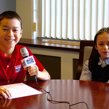 Maxwell interviews young reporter Shayna Rose in Boston.