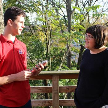Erik talks with Elisa Jones who is visiting the U.S. from Wales.