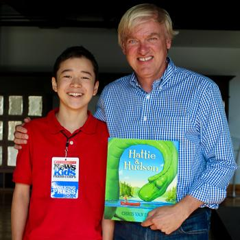 Max with children's author and illustrator Chris Van Dusen.