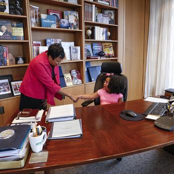 Daliyah gets to sit at Hayden's desk at the Library of Congress.